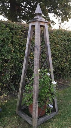 The Oak Spire Obelisk design provides a stunning feature in the garden, standing a statuesque 7 or 8 foot tall, hand crafted from Oak with Copper trellis.