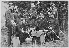 "A group of foreign observers with Maj. Gen. George Stoneman at Falmouth, Virginia. Some foreign observers, like Prussian observer Moltke, remarked that the American Civil War was nothing but a matter of ""two armed mobs chasing each other around the country, from which nothing could be learned."" Others, however, noted the American Civil War as the first railroad war and a premonition of the trench warfare of WW1."