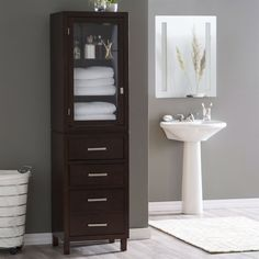 Clean linens, clean lines – that's the story, in a nutshell, of this Espresso Wood Linen Tower Bathroom Storage Cabinet with Glass Paneled Door. Crafted with durable MDF and solid hardwood (some color #bathroomcabinetsluxury