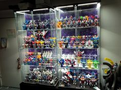 A complete guide to Do-It-Yourself lighting for your IKEA Detolf. Ikea Detolf, Hot Wheels Display, Nerd Cave, Hobby Room, Cabinet Lighting, Displaying Collections, Home Hacks, Game Room, Tricks