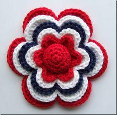 Vil de prøve å hekle ein blomst?     (Sidan 17. mai er over for denne gongen lagar eg ein litt meir sommaraktig blomst også.)   Would you li...