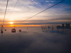 Above the clouds of London on the Emirates Air Line cable car Sky Ride, London Transport, Fantasy Images, Above The Clouds, Time Out, Ireland Travel, Great Britain, That Way, Cool Photos