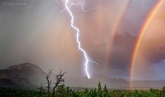 2016 FINALIST - A monsoon storm brings lightning and rainbows to the Sedona area. Photo by: Peter Gassner