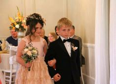 Bridesmaid in her pink dress accompanied by a handsome young man.