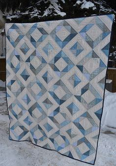 This quilt looks so pretty agains the snow background. The Blue Quilt by shecanquilt, via Flickr
