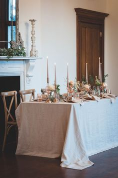 Neutral soft linen table cloth draped to floor.  Cross back wooden chairs.  Soft neutral colours for wedding table. Top Table Ideas, Table Centerpieces, Table Decorations, Neutral Colors, Colours, Wedding Tablecloths, Wooden Chairs, Wedding Table Settings, Linen Tablecloth