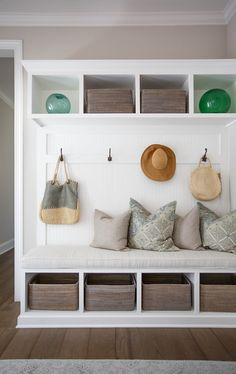 I like the shoe baskets and storage overhead, as well as bench seating