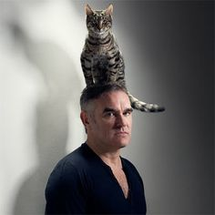 "Morrissey Fanny the Bengal and Moz, by Jake Walters, ""It's a well-known fact that unlike dogs, cats do as they please. And it's exactly this which makes the brilliant image of Morrissey with a cat on his head so uttlerly brilliant. Crazy Cat Lady, Crazy Cats, I Love Cats, Cool Cats, Celebrities With Cats, Men With Cats, Gatos Cat, Cat Hat, Cat People"