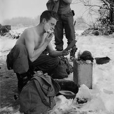This American soldier shaves in the cold during a lull in the fighting in the Battle of the Bulge    Read more: http://www.dailymail.co.uk/news/article-2075565/Vivid-new-Battle-Bulge-photos-offer-seen-look-war-weary-soldiers-braving-frigid-weather-fight-Nazi-Germanys-major-offensive-World-War-II.html#ixzz2GOhnMb9l  Follow us: @MailOnline on Twitter | DailyMail on Facebook