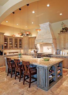 The large island in this European inspired kitchen offers plenty of space for both cooking and social gatherings. Gorgeous!