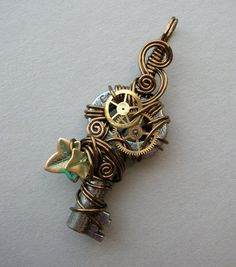 Steampunk Key Pendant -- Antiqued Brass Ivy Leaf Wire Wrapped Clockwork Key Pendant (A key to time) -- Skeleton Key and Gears Pendant /// $42 /// from silverowlcreations on etsy.com