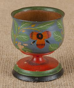 """Joseph Lehn (Lancaster County, Pennsylvania 1798-1892), turned and painted egg cup with a blue ground, 2 3/4"""" h. pook & pook"""