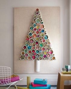 Cross sections of PVC pipe come together to form a tree with built in ornament storage. Use different widths of piping to house baubles of various shapes and sizes. Photo: Martha Stewart