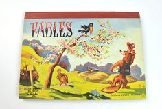 This RARE and wonderful pop-up French edition of Fables, with illustrations by Gildas, comes from Lucos, Mullhouse, 1950s. This vintage book for kids is printed in landscape format with six pop-up tableaus and French text. I have examined the book carefully and find the pops and text to be in lovely vintage condition -- clean, clear of marks, rips, tears, creases, stains. The covers show expected wear, with bumping at corners, some smudging, and edge wear. Otherwise, this is a marvelous…