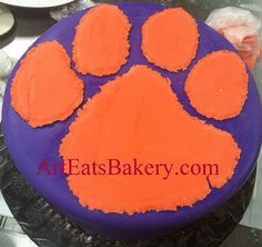 Purple and orange fondant Clemson tiger paw