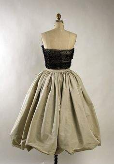 Balenciaga couture evening dress 1959 Eisa label collection made from silk and tulle. Black and pale grey gather sheath style design with a detachable bubble puff skirt. Cristobal Balenciaga, EISA was named after the designer's mother, a seamstress.