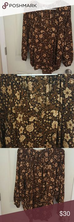 Brown floral blouse I have a brown flowy blouse,  has a slightly longer back so it'll look cute with leggings or jeans.  It's super flowy runs a little big Amuse society   Tops Blouses