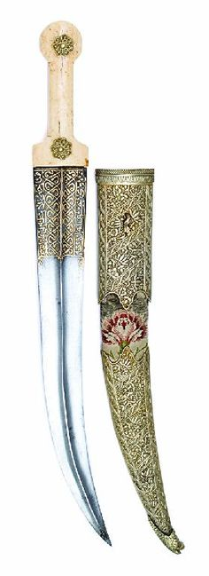 A FINE PERSIAN KINDJAL, 19TH CENTURY with curved broad blade formed with a medial rib over its full length, the lower portion decorated with gold koftgari scrollwork at the forte, morse hilt of characteristic form fitted with a pair of white metal foliate washers, in its fabric-covered wooden scabbard with large white metal mounts decorated with repousée flowers and foliage against a punched ground