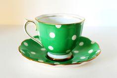 How cute!  Vintage Royal Albert Teacup & Saucer Green Polka Dot Bone China with Gilt Rim. $130.00, via Etsy.