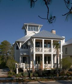 The Finley Plan by Allison Ramsey Architects built at Seagrove in Carolina Beach, North Carolina. This plan is 2670 Heated Square Feet, 4 Bedrooms and 3 Bathrooms. Carolina Inspirations Book II, Page 14, C0354. Imagine it with no cupola on top and a more traditional porch rail like on Oprah's house.