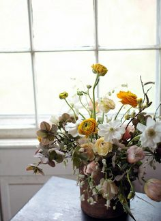 Wildflower arrangement - this is a winter/spring arrangement, but we might be able to get ranunculus