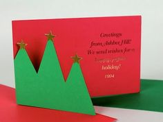 The Cut-Out Tree Card | 49 Awesome DIY Holiday Cards http://www.ashbeedesign.com/2011/11/diy-christmas-cards-trees-as-theme.html