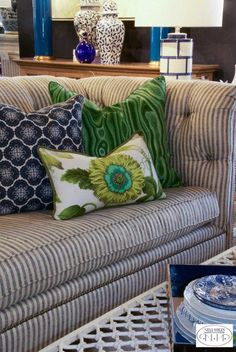 Freshen up your furnishings with spring-inspired pillows. We love over-sized florals and precious-stone inspired patterns this year. Living Room Decor Country, New Living Room, Living Room Sofa, Striped Couch, Ticking Stripe, British Colonial Style, White Couches, Find Furniture, Fabric Sofa