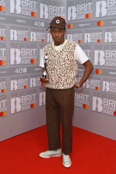 At the 2020 Brit Awards, Tyler posed with his award wearing a funky animal-print sweater vest, a Golf Wang hat, and Converse. Tyler The Creator Fashion, Tyler The Creator Outfits, Sweater Vest Outfit, Vest Outfits, Cool Outfits, Mens Sweater Vest, Vest Men, Mode Streetwear, Streetwear Fashion