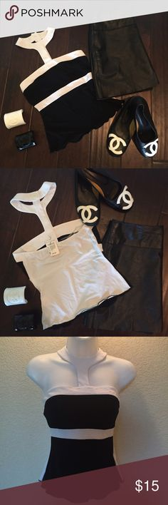 7/28 HP🎉🎉 Black & White Color Block Top sz Small BNWT black and white color block top by ❤️🌙⭐️ . Bought in the Rampage Boutique at the Florida Mall. Top has a unique neckline. New with tags. A few minor marks from being in storage but still new. Matches perfectly with Chanel flats. Open to trades with positive trade history.  No low ball offers. Heart Moon Star Tops Tank Tops