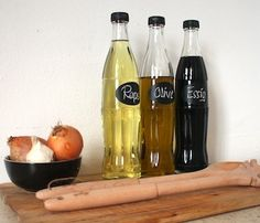 Empty glass soda bottles turned into oil/vinegar containers. Eine tolle Idee! :)