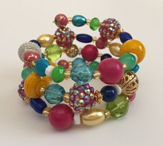 Whimsical Sparkly Pink, Blue, Green, Yellow, White and Gold Beaded Coil Bracelet by PeacocksandLeopards on Etsy $26