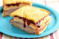 Baked Monte Cristo Sandwich -- With Raspberry Preserves, Muenster Cheese, And Deli Meat Served On Crescent Rolls. Monte Cristo Sandwich, Delicious Sandwiches, Wrap Sandwiches, Baked Sandwiches, Party Sandwiches, Soup And Sandwich, Sandwich Recipes, Sandwich Board, Sandwich Spot