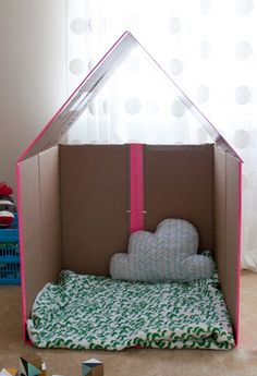 Collapsible Cardboard Play House for Kids great for storing and moving and easy to do too!