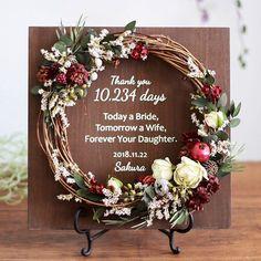 Pomegranate and berry. 結婚式でご両親へ これまでの感謝の気持ちをつたえる リースボード ご好評いただいたホーリーローズが装いも新たに 柘榴やベリーをそえたローズベリーとして明日から新しく仲間入りです 深みのある赤いベリーにクラシカルなバラユーカリドライの小花や実物を添えました 柘榴の赤が大人っぽく愛らしくて素敵な色です 明日の夜には販売スタートできる予定ですぜひご覧ください .  プロフィールのURLからいろいろなリースや木製ボードをご覧いただけます 木製ボードにはお名前と記念日挙式日などなどを印字してご注文から2週間でお届けいたします . ボードのカラーはホワイトウォルナットの2種類 リースはドライプリザーブドアーティフィシャルのミックスです リースの部分はオーダーもOK(フルオーダーはただいま約2ヶ月お時間をいただいております) お問い合わせご注文はHPから承っています . . #ウェルカムボード #ウェルカムスペース#受付サイン #オーダーメイド #ウェディングブーケ #リース #結婚式準備 #2018夏婚 #2018春婚 #両親贈呈品 #新築祝い… How To Wrap Flowers, How To Preserve Flowers, Flower Decorations, Wedding Decorations, Christmas Decorations, Floral Wedding, Wedding Bouquets, Beauty Room Decor, Cute Room Decor