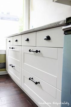 Drawer pulls @Southern Hospitality Rhoda 1979 kitchen renovation is entirely Ikea Adel with Kashmir granite countertops.