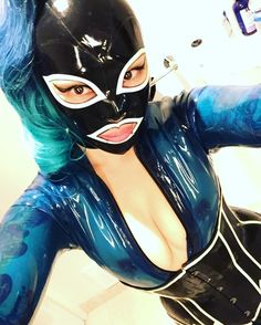 Blue catsuit kisses #bluelatexcatsuit #latexobsessed #rubbergirl #latexhood