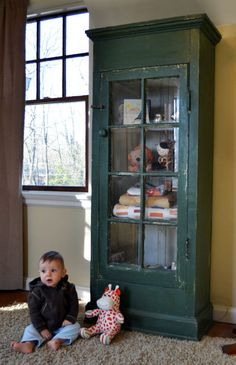 Vintage window + salvaged wood moldings = fabulous shabby chic green painted curio (adorable baby not included) $250