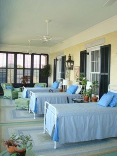 Traditional Bedroom by WARD A LILE DESIGN - sleeping porch - note shutters and lanterns on screened porch!