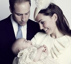 As his mother cradled him close for his official portrait George gazed lovingly into her eyes before letting out a burst of giggles for this...