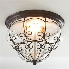 "Fasciati Ceiling Light  This unique ceiling light adds that fascinating touch to your room. In classic Italian style, handblown clear glass is wrapped with delicate black wire to create the artistic shape that has endured generations. 2x40 watts. (medium base socket) (9.5""Hx14""W)  	  Product SKU: FM12027 BK  Price:  $149.00"