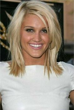 The top layer features the shortest length, while the lower locks are layered slightly for an angled layered hairstyle.