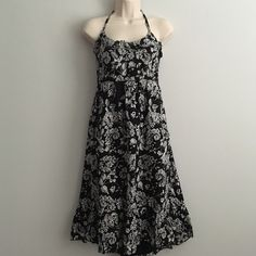 Halter Top Floral Dress Black and White Halter Top Dress/Never been worn/Excellent condition/From waist to bottom it is about 27 inches Old Navy Dresses
