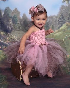 Kiyomi's Big Girl Leopard print tutu dress with matching headband. made with love by her mommy $45