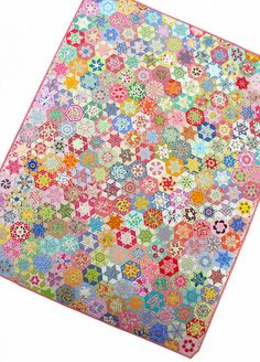 Hand Pieced Hexagon Star Quilt Please let me start by telling you that this isn't my work. Instead, this is a recently completed hand-pieced quilt made by my mother-in-law