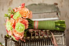 Colorful Round flowers wrapped with a green Ribbon.