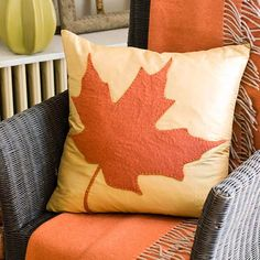 Add an oversized maple leaf embellishment to make a pillow pop. More cozy fall crafts: http://www.bhg.com/thanksgiving/crafts/cozy-fall-crafts/