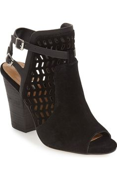 Geometric cutouts and strappy slingback styling refresh this stacked-heel suede bootie that's finished with an alluring peep toe.