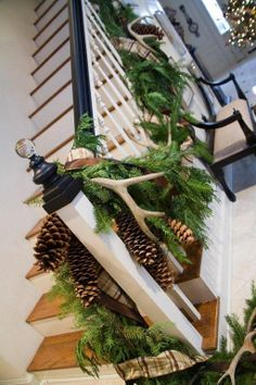 Natural Christmas Decor.. Antlers.    Staircase.   Love this for those of us who have a plethora of antlers from our hunters!