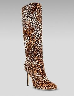 "Jimmy Choo Calf Hair Pull On Boot  Furry, ferocious boots let the city know you´re an apex predator.  Dyed, leopard-printed calf hair (Italy).  Subtle topstitching joins panels for clean-line design.  Almond toe.  4"" stiletto heel.  Leather lining and sole.  To-knee shaft, approximately 14""H."