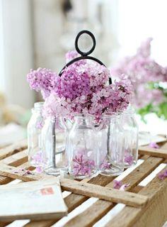 lilacs in glass jars